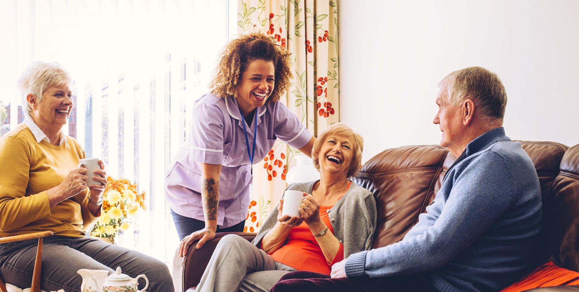 happy seniors with caregiver
